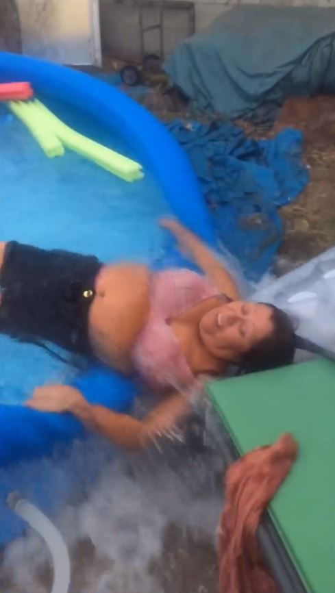 Adults Playing in a Kiddie Inflatable Pool is Hilariously Funny image