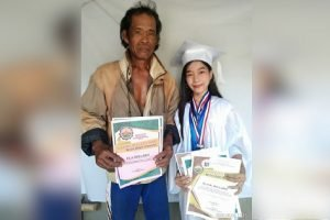 Farmer's Daughter Proudly Shares Graduation Photo with Dad